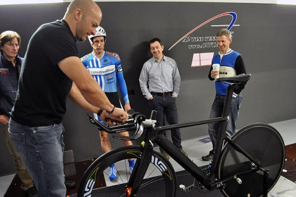 A2 Wind Tunnel's Mike Giraud makes an adjustment to the prototype Boardman time trial bike ridden by UnitedHealthcare's Scott Zwizanski