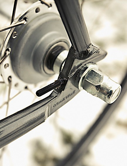 The 3-speed Sturmey Archer hub is mated to a simple twist grip shifter and Sturmey chainset, maintaining Cooper's all-British theme