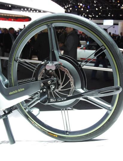 The custom rear wheel contains a Bionx electric motor; the battery is presumably internal to the frame and slung low near the bottom bracket