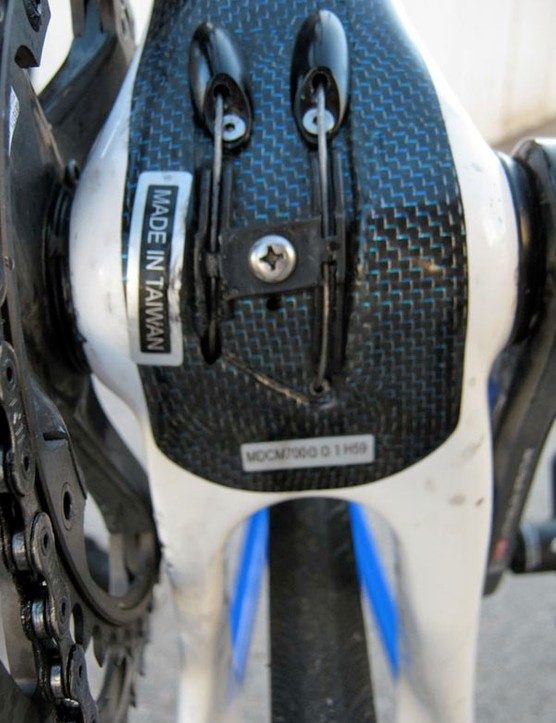 The internally routed cables make a brief appearance beneath the bottom bracket shell.