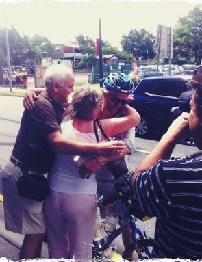 Oli hugging his mum and dad on arrival at The Gabba in Brisbane