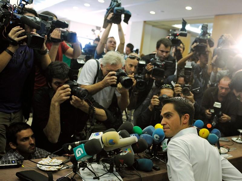 Alberto Contador surrounded by media
