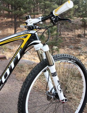 The tapered head tube, stiff carbon structure, and 15mm thru-axle dropouts make for a precise-handling front end