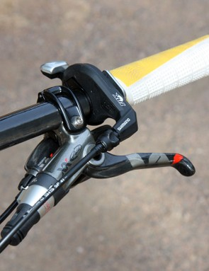 The Fox remote lockout lever (made by Shimano) neatly tucks in between the grip and SRAM XX controls
