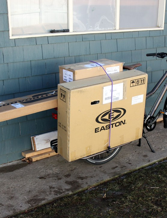 Can you really fit a snowboard on a cargo bike?  Why yes, yes you can