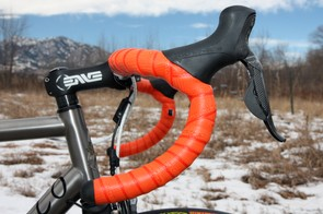 The Enve Composites carbon bars are covered in Lizard Skins DSP tape to match the Mad Fiber decals