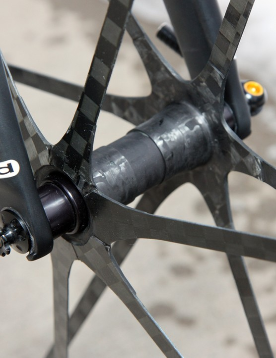 The Mad Fiber hubs are made wholly of bonded carbon fiber save for the bearings and axle assembly