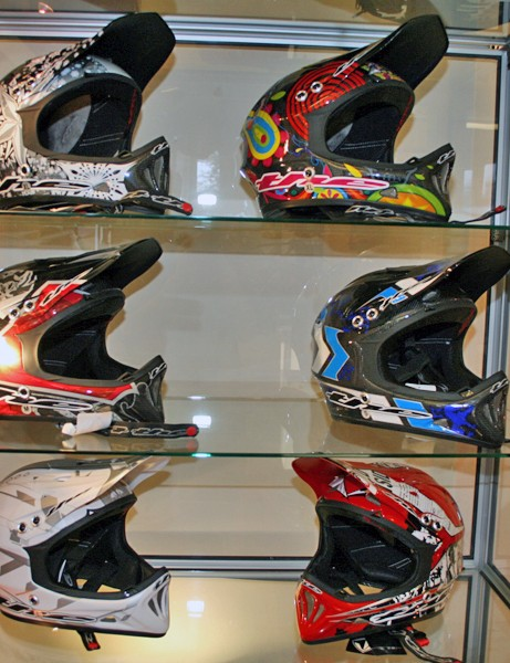 THE T2 Carbon (top two shelves) and T2 Composite helmets