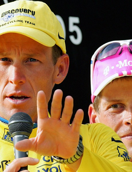 Lance Armstrong with his great rival Jan Ullrich in the background