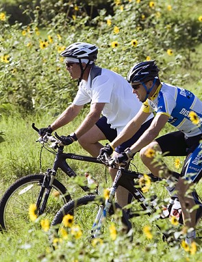 Armstrong rides with then US president George W Bush