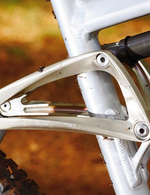 Four-bar rear end with  forged rocker link yields a  linear suspension feel
