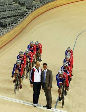 Members of Team GB ride past Dave Brailsford and Lord Seb Coe