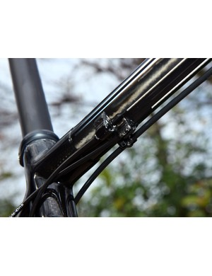Carbon fiber cable guides are used on KirkLee's mountain bike frame.