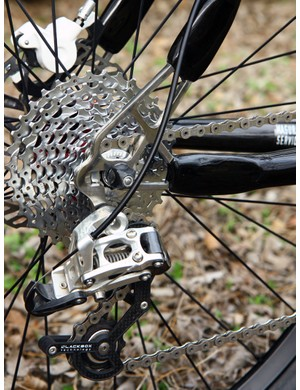 The polished titanium plate dropouts on KirkLee's mountain bike frame can be used with either geared or singlespeed drivetrains.