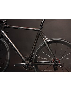Clean lines and modestly sized tubes are featured on this KirkLee carbon road frame.
