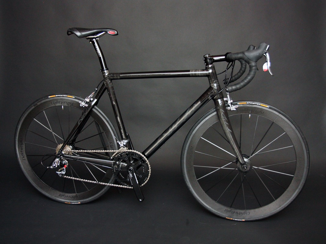 """KirkLee built this bike to be """"as black as black"""" with subtle frosted logos."""