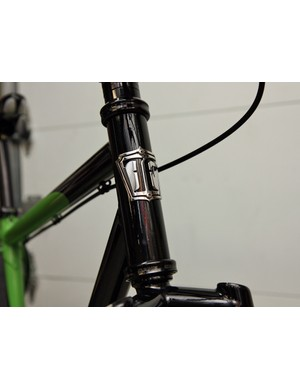 True Fabrication's head tube badges are cut with a water jet and then bent as needed.
