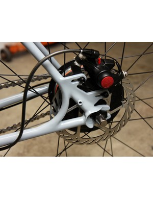 Simple slotted dropouts and brake mounts are included in this True Fabrication townie bike.