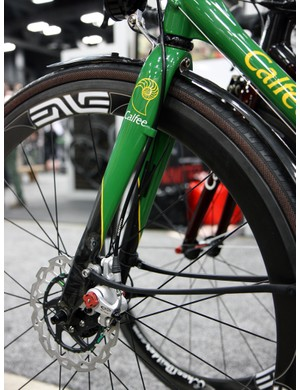Calfee starts with an Edge 2.0 carbon road fork and then adds on disc tabs and a hose guide.