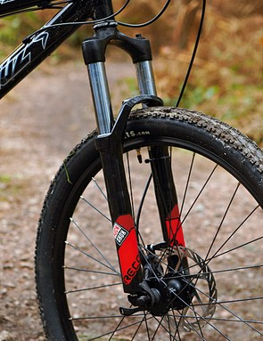 Steel-stanchioned Recon fork adds heft and lacks tunability, but does the job without fuss