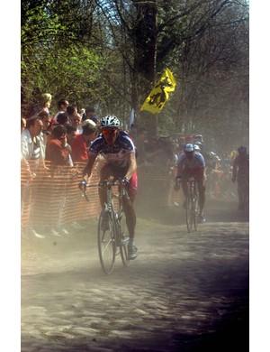 A rider battles his way over the Paris-Roubaix cobbles