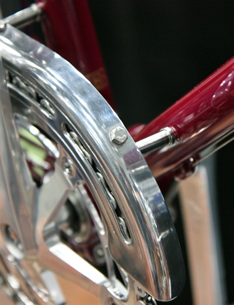 The chain guard firmly and securely affixes to the frame via these stout standoffs