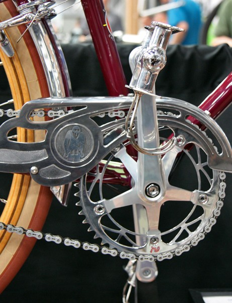 Brett Horton says the inspiration for both bikes came from this vintage CLB chain guard, which was modified with The Horton Collection logo, deburred, and polished