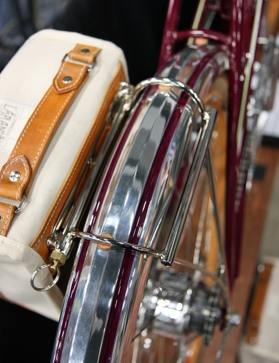 The fenders attach to the frame but also to the rear rack with hidden hardware and leather washers