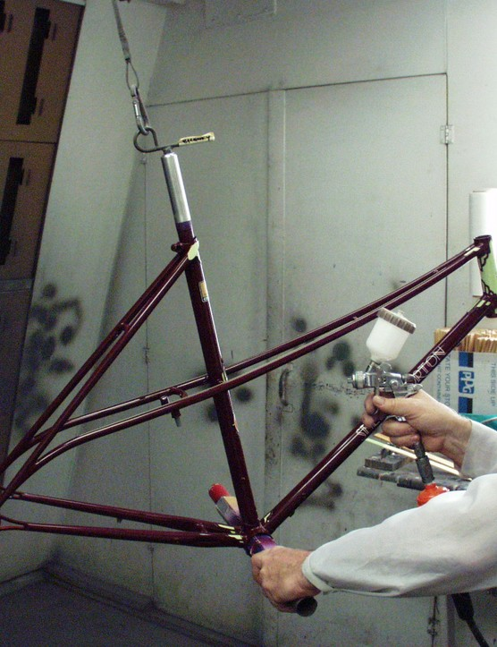 Joe Bell applies one of 17 separate coats to Shelly Horton's Bilenky Cycle Works frame