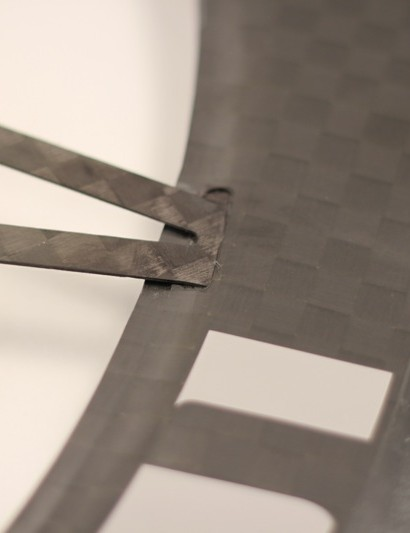The wheelset's carbon components are bonded using a special film adhesive