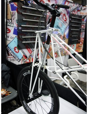 The front end of Kimori's small-wheeled bikes include a parallelogram-type suspension linkage