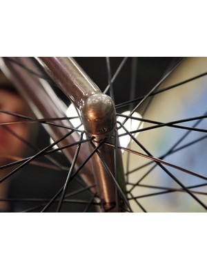 The front wheel on Naked's city bike uses hidden hardware to secure the axle. After loosening the set screws, one has to then spread the fork tips to remove the front wheel