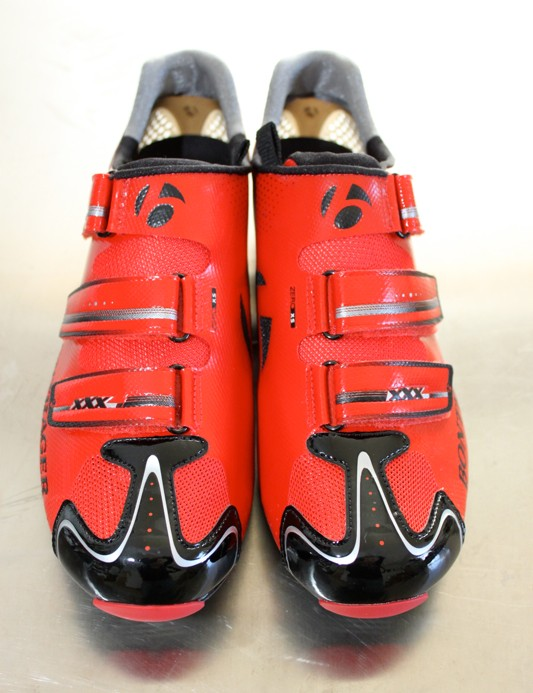 The shoes feature three strap Velcro closure