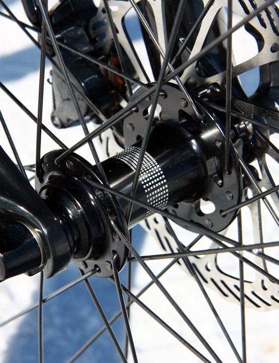 There's no thru-axle front end but Specialized has equipped the Epic Comp Carbon 29 with extra-large diameter hub end caps and a thru-bolt skewer (the return of the Skraxle!) that provides a noticeable bump in steering precision over standard quick-release front ends in technical terrain