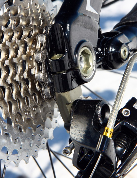 In the event of a crash, the derailleur hanger isn't meant to break or bend but rather the alloy bolt that attaches it.  Specialized conveniently includes an extra one with the bike, too