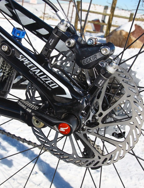 The post mount rear tabs will accept a 140mm rear rotor should you decide to shed a few grams