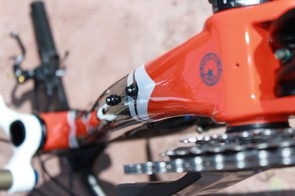 The down tube features bottle mounts within the front triangle and below