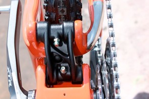 The reason for the asymmetric design of the lower linkage is to allow for use of a bottom bracket mounted chain guide