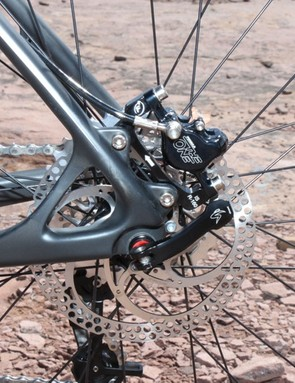 The non-drive dropout and disc brake mount are molded from carbon