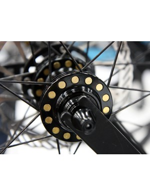Cole's spoked wheels use freely rotating aluminum barrels to seat the spoke heads in the hub flange, saying they allow for more precise spoke alignment and higher tensions