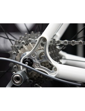 Guru took the typically mundane concept of a replaceable derailleur hanger and turned it into a styling element on their titanium road bike