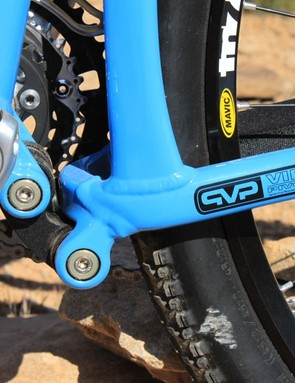 The VPP linkage rotates on adjustable angular contact bearings, which have grease ports for maintenance; each bike is shipped with a grease gun
