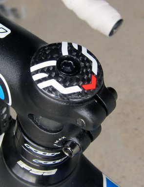 The carbon fiber stem cap is anchored in place with a surprisingly short alloy bolt