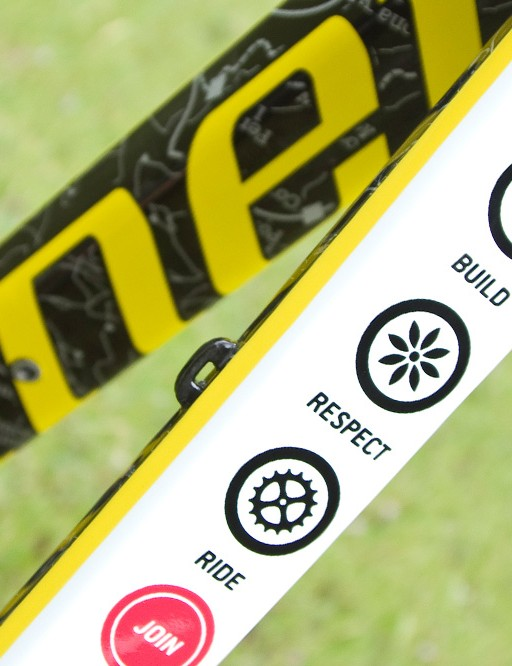 The top tube features IMBA's