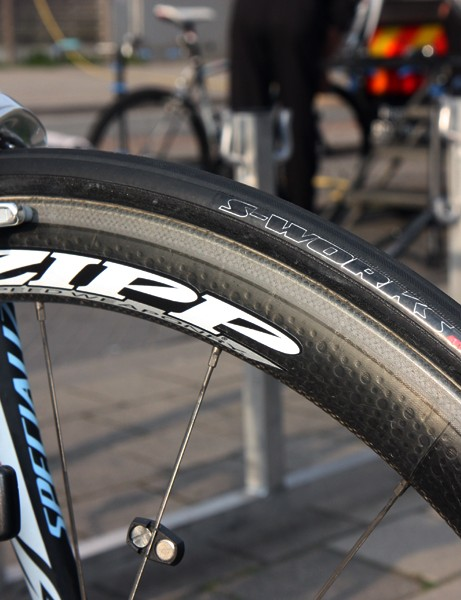 Zipp 303 rims are wrapped with Specialized S-Works tubular tires made by Veloflex.