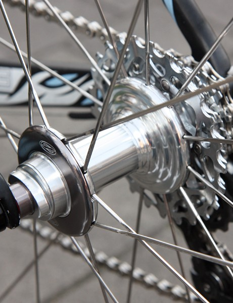 Zipp's latest hub design uses straight-pull spokes and large-diameter flanges, plus adjustable bearing preload.