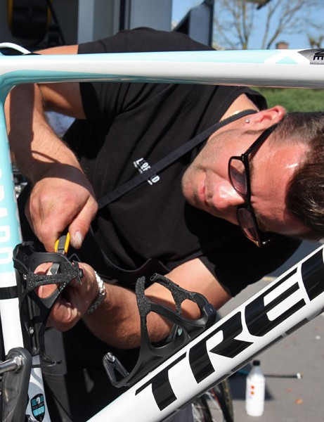 Leopard Trek mechanic Roger Theel trims the edges of the friction tape applied to one of the team's bottle cages.