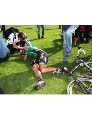 Europcar's Damien Gaudin collapses on the infield after the finish of Paris-Roubaix.