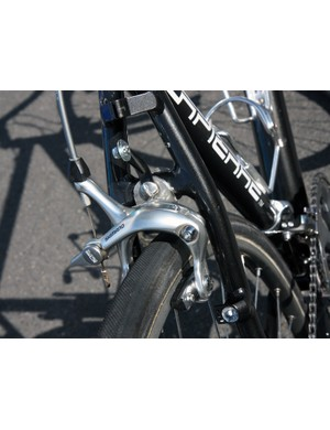 The rear brake is affixed to the frame in essentially the same manner as the front - with two steel plates and an extra set of bolts sandwiching the stock brake bridge