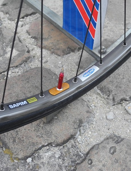 Quick-Step's Ambrosio wheelsets have been through a number of editions of Roubaix and different wheel sponsors; many had layers of sticker glue on them
